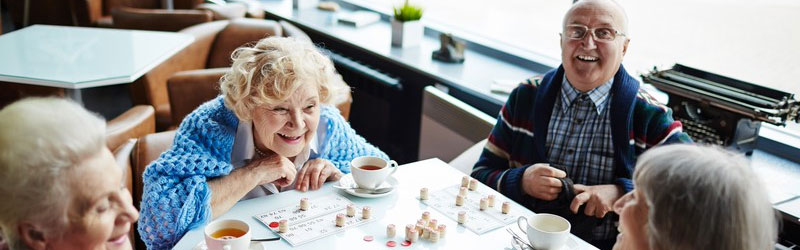 group of older people playing a board game